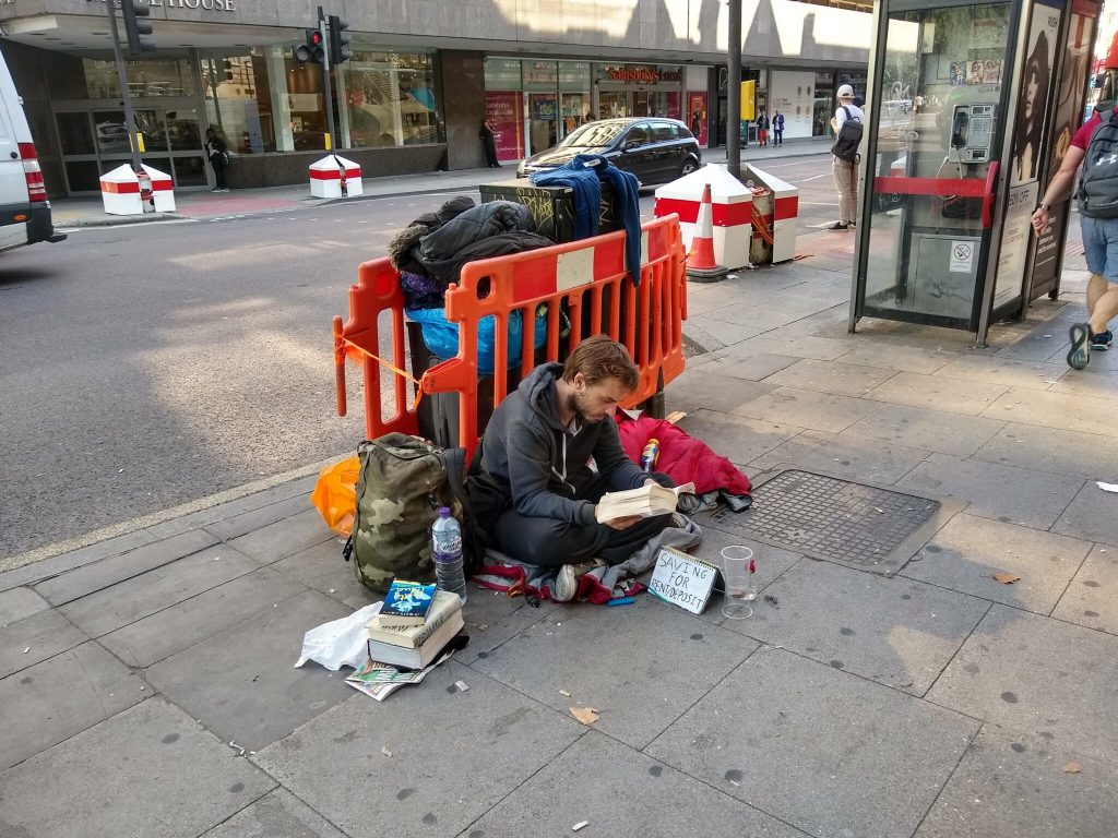A rough sleeper on Tottenham Court Road, London. Philafrenzy