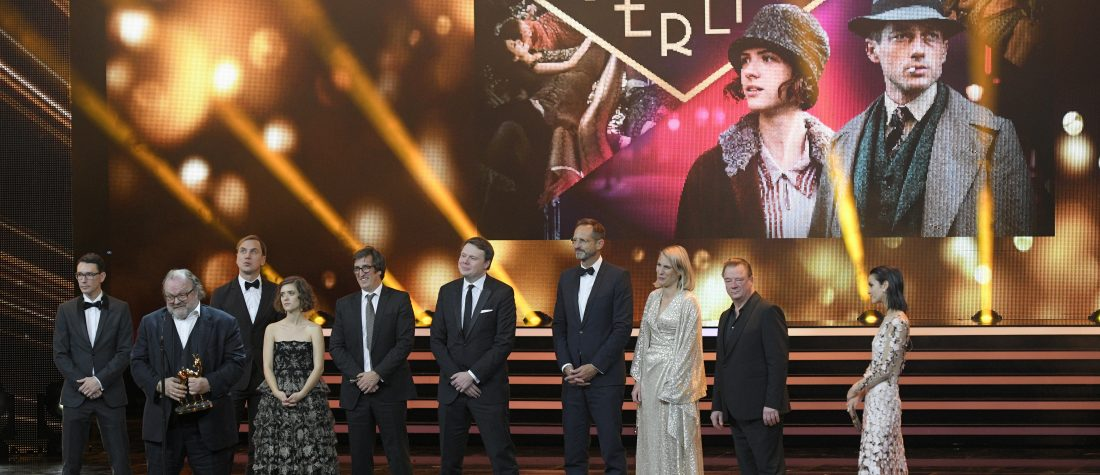 Members of the cast and crew of Netflix's hit German TV series Babylon Berlin pick at the Bambi Awards in Berlin, 2018. Robert Schlesinger/Getty Images