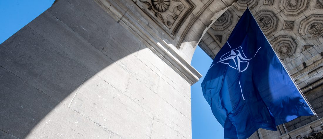 BRUSSELS, BELGIUM - JUNE 14: A NATO flag hangs from the Triumphal arch at Parc du Cinquantenaire on June 14, 2021 in Brussels, Belgium. World leaders convene in Brussels at the NATO headquarters for the 2021 summit. The North Atlantic Treaty Organisation was created in 1949 in military defence against the Soviet Union. (Photo by Jean-Christophe Guillaume/Getty Images)
